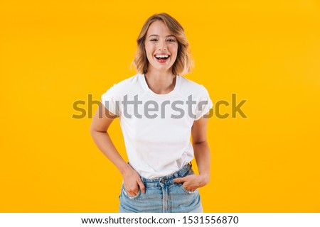 Photo of pretty blond woman in basic clothing smiling and showin Stock photo © deandrobot