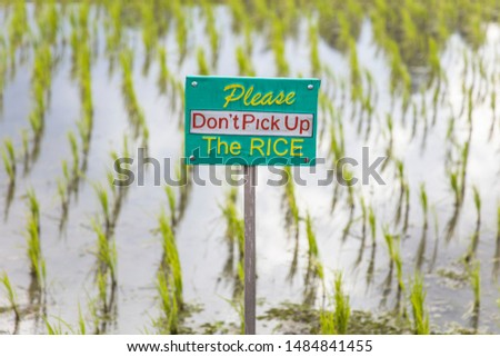 tourists warning sign at rice fields of jatiluwih in southeast b stock photo © boggy