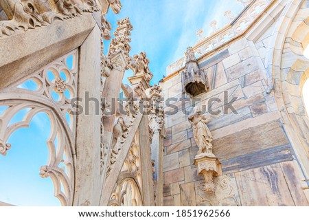 White marble statues on the roof of famous Cathedral Duomo di Mi Stock photo © boggy