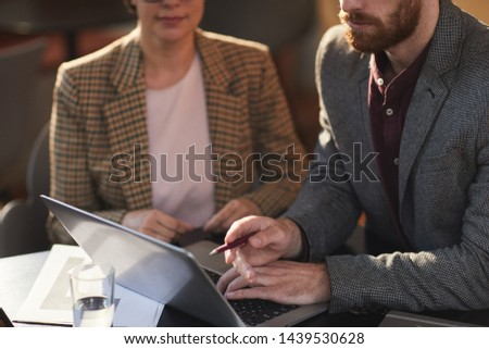 mid section of business people discussing on laptop in restaurant stock photo © wavebreak_media