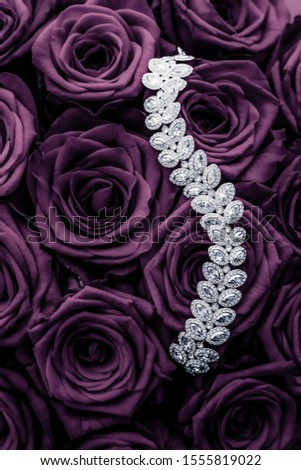 Luxury diamond jewelry bracelet and purple roses flowers, love g Stock photo © Anneleven