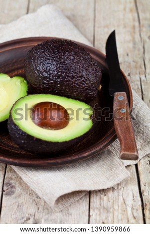 Fresh organic avocado on ceramic plate and knife on  linen napki Stock photo © marylooo