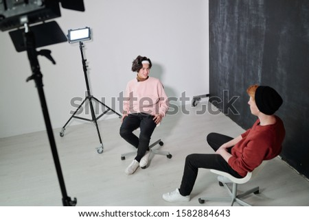 Two friendly vloggers discussing contemporary sources of information Stock photo © pressmaster