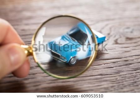 Person Scrutinizing A Car Model Stock photo © AndreyPopov