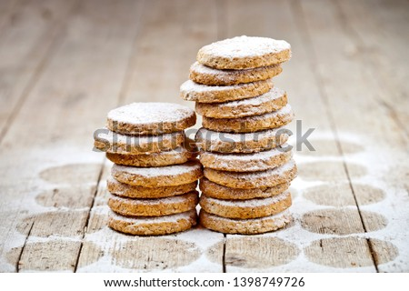 Fresh baked oat cookies with sugar powder on rustic wooden table Stock photo © marylooo
