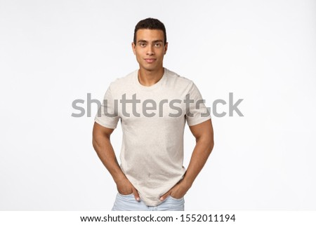 Muscular handsome hispanic man with short haircut, strong biceps, hold hands in jeans pockets and sm Stock photo © benzoix