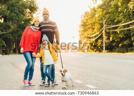 Happy family wear warm clothes walk with dog on road, stand clos Stock photo © vkstudio