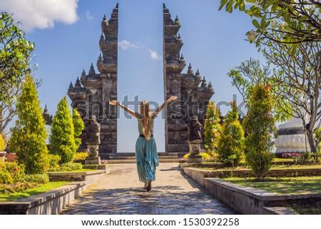Young woman tourist in budhist temple Brahma Vihara Arama Bali TRANSLATION The abilities of people p Stock photo © galitskaya