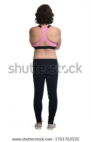 Image of woman in sportswear standing from back with arms on wai Stock photo © deandrobot