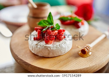 Grilled camembert cheese with strawberry, honey and basil leaves, delicatessen Stock photo © Illia