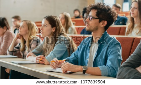 group of students with notebooks on lecture Stock photo © dolgachov