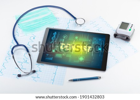 Tablet pc and medical stuff  Stock photo © ra2studio