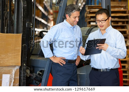 Asian warehouse manager discuss with worker Stock photo © vichie81