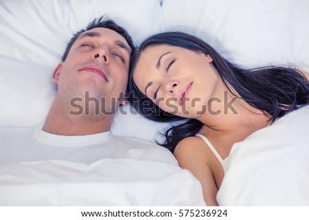 Sorridente moço travesseiro cama telefone móvel Foto stock © deandrobot
