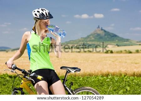 biker with bottle of water hazmburk ceske stredohori czech re stock photo © phbcz