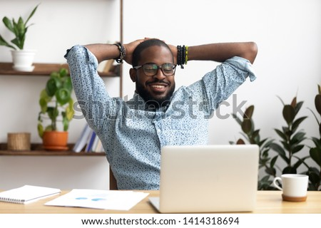 Relaxed man sitting at a desk Stock photo © photography33