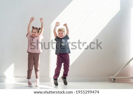 happy little child posing in studio Stock photo © jirkaejc