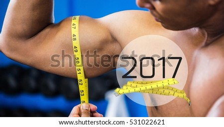 close up of a part of a yellow measuring tape against a white background stock photo © wavebreak_media