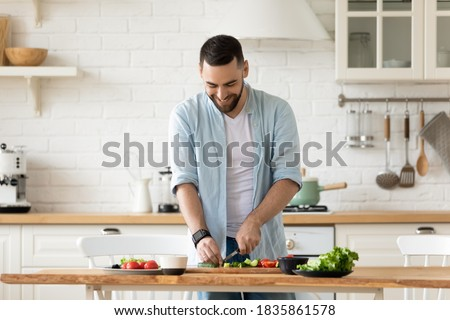 Young handsome man preparing to eat fresh healthy salad sitting  Stock photo © HASLOO