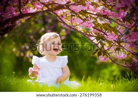 smiling baby in summer garden Stock photo © Mikko