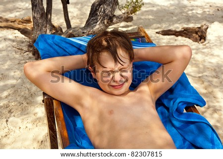 cute young boy at the beach closes eyes because of bright sunlig Stock photo © meinzahn