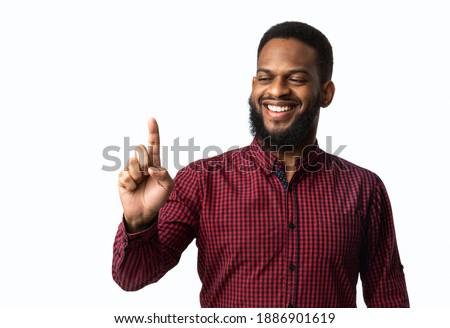 Boldog lezser férfi tart láthatatlan termék Stock fotó © deandrobot