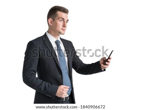 ernstig · bebaarde · zakenman · pak · naar · mobiele · telefoon - stockfoto © deandrobot