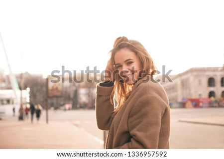 attractive glamourous woman walking and fixing her sunglasses stock photo © deandrobot