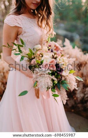 beautiful brunette bride wedding portrait holding roses bouquet stock photo © victoria_andreas
