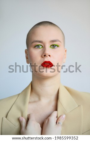 Portrait of seductive shirtless young woman with creative makeup Stock photo © deandrobot