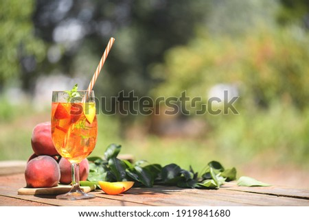 Stock photo: Homemade lemonade with ripe  peaches and fresh mint. Fresh peach