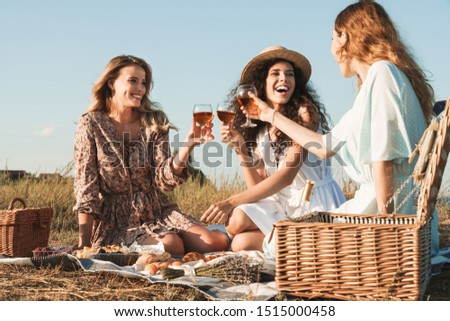 three young happy woman laughing drinking red wine having fun stock photo © dashapetrenko