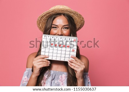 Image of excited brunette woman 20s in straw hat holding colorfu Stock photo © deandrobot