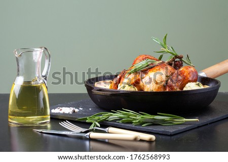 Roasted whole chicken or turkey served in iron pan with Christmas decoration Stock photo © dash