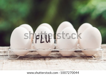 Stock photo: Sign FLU on the egg. The concept of disease. Avian influenza, salmanese