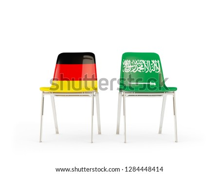 Two chairs with flags of germany and saudi arabia isolated on wh Stock photo © MikhailMishchenko