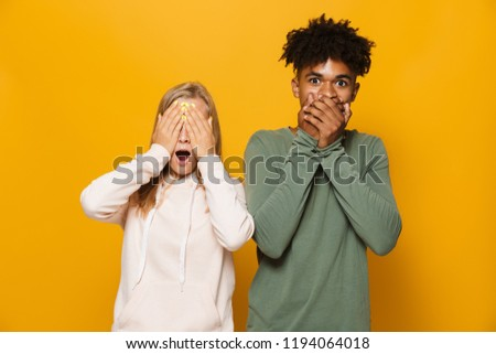 photo of excited couple man and woman 16 18 with dental braces c stock photo © deandrobot