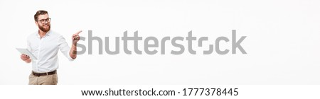 happy young bearded man standing isolated over white wall background make thumbs up gesture stock photo © deandrobot