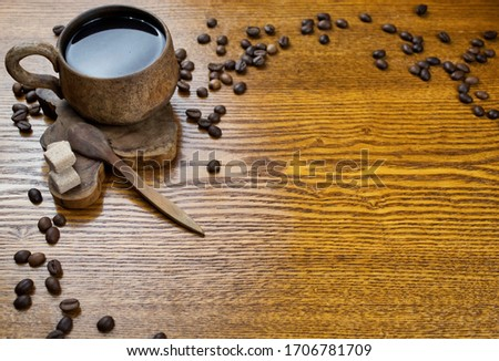 Cup of espresso, sugar cubes and chocolate candy on rustic wooden background Stock photo © Melnyk