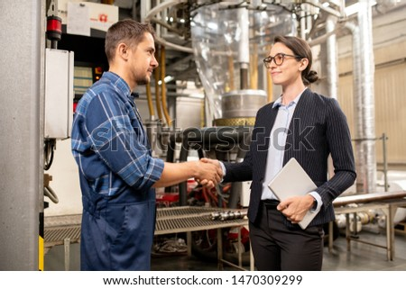 Young female partner shaking hand of engineer of chemical processing factory Stock photo © pressmaster