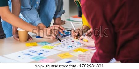 Creative UI designer teamwork meeting planning designing wirefra Stock photo © snowing