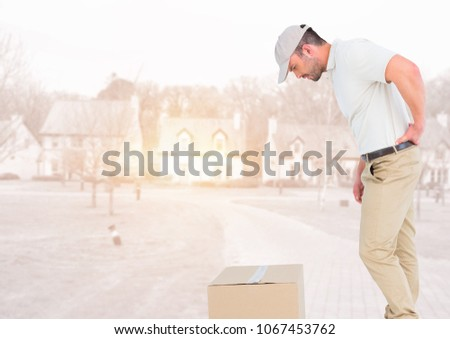 Delivery man looking at box against blurry housing estate with flares Stock photo © wavebreak_media