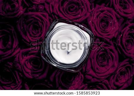 Face cream skin moisturizer and dark purple flowers, luxury skin Stock photo © Anneleven