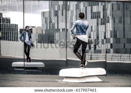 Young brunette female standing in front of mirror with consultant near by Stock photo © pressmaster