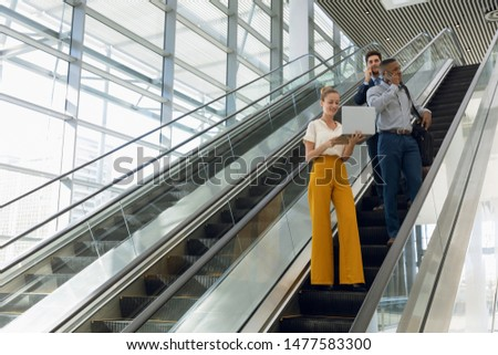 Low angle view of young African-American businessman using mobile phone standing in modern office Stock photo © wavebreak_media
