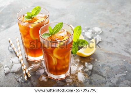 Two glasses with cold traditional iced tea with lemon, mint leav Stock photo © marylooo