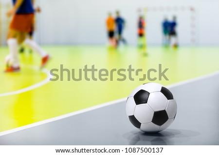 Indoor Soccer Background. Futsal Junior Player on Indoor Training. Soccer Goal with Yellow Net. Socc Stock photo © matimix