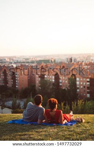 Couple lay grass Stock photo © Lopolo