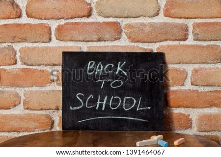 Black chalkboard with the phrase BACK TO SCHOOL drown by hand on Stock photo © marylooo