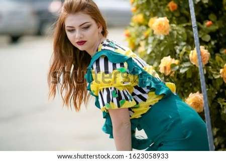 Woman chereful smile sitting leaning on the fence on the street in bright clothes Stock photo © ElenaBatkova